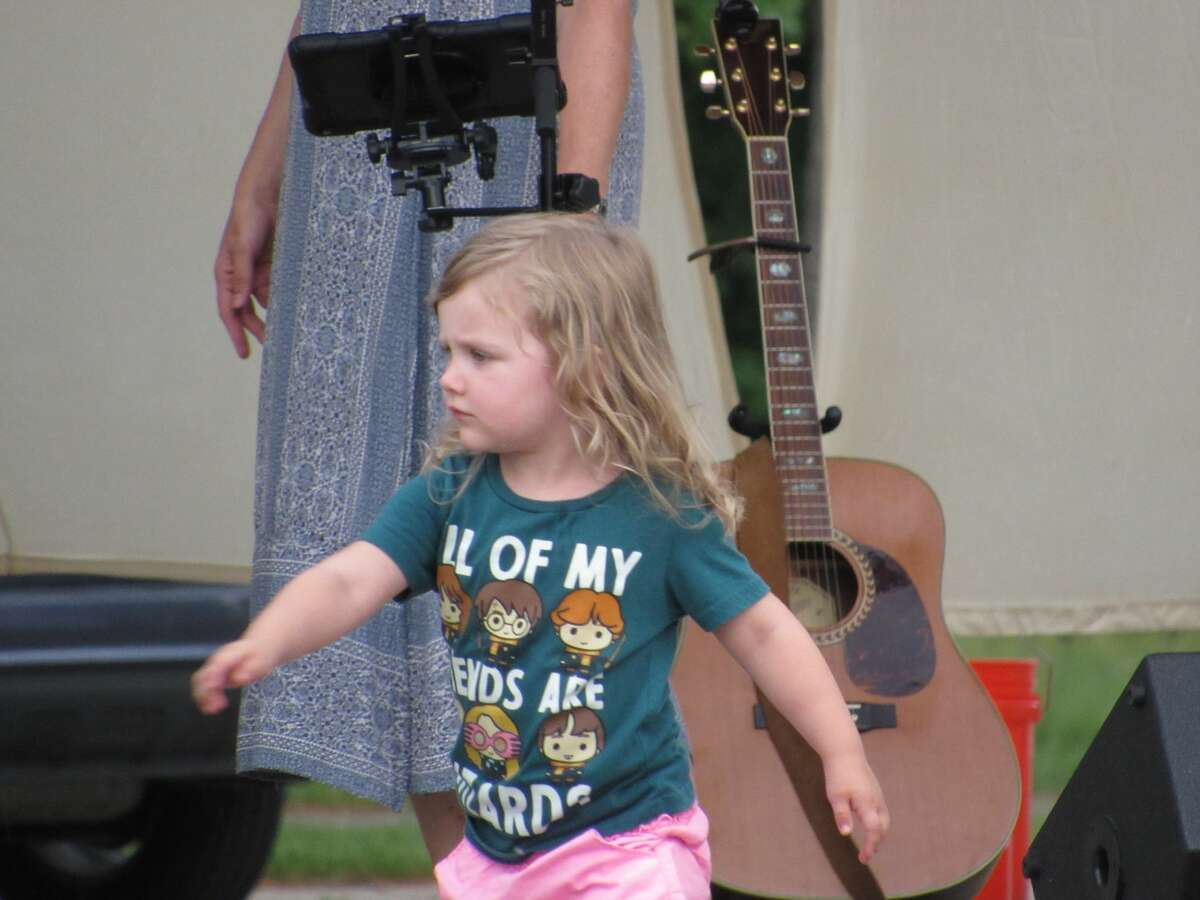 Robin Abbott's 3-year-old daughter, Lila, dances in front of the stage during the Ladies of the Lake concert on Saturday, June 12.