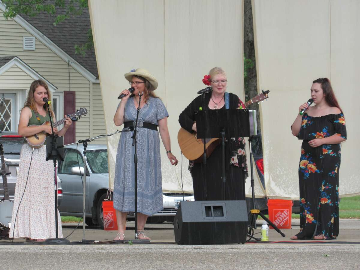 Robin Abbott, Kristine Goodwin, Lee Ann Whitman and Hillary Huebler-Almy perform on Saturday, June 12 in Coleman as part of the Ladies of the Lake concert.