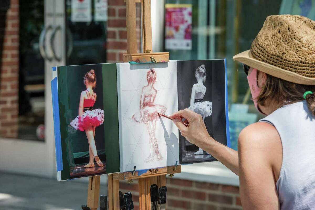Cindy Wagner, of Weston, works on a painting during Ridgefield Guild of Artist's Art Walk on Saturday, August 22, 2020.