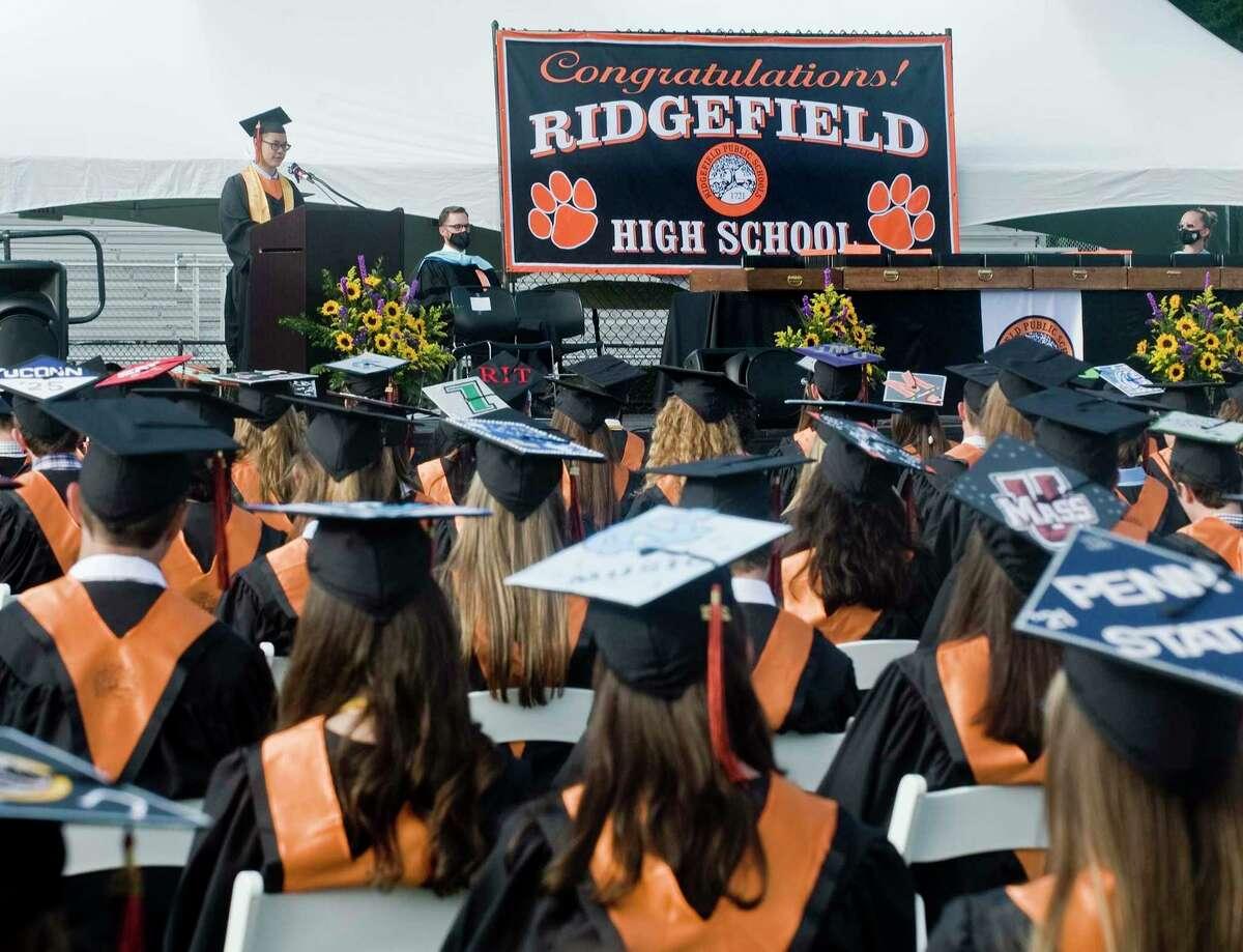 Valedictorian Kenneth Choi addresses to the Ridgefield High School community during graduation. Friday, June 11, 2021.