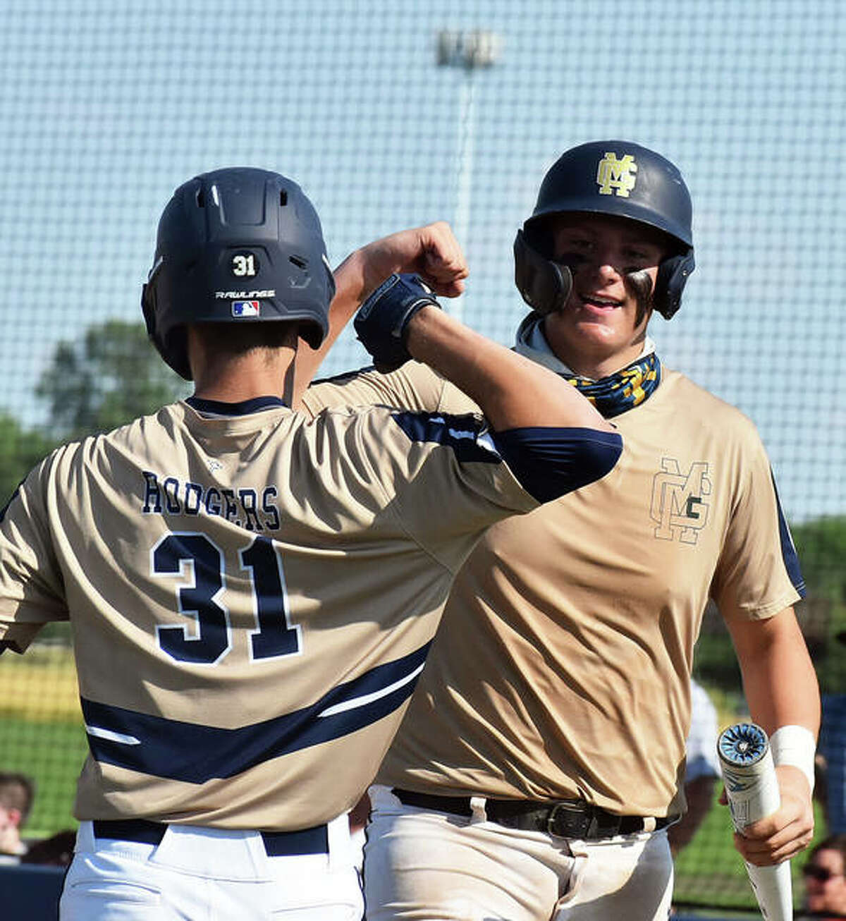 Father McGivney's Gabe Smith, right, celebrates with Jackson Rodgers after scoring a run in the first inning against Greenfield in a Class 1A sectional championship game.