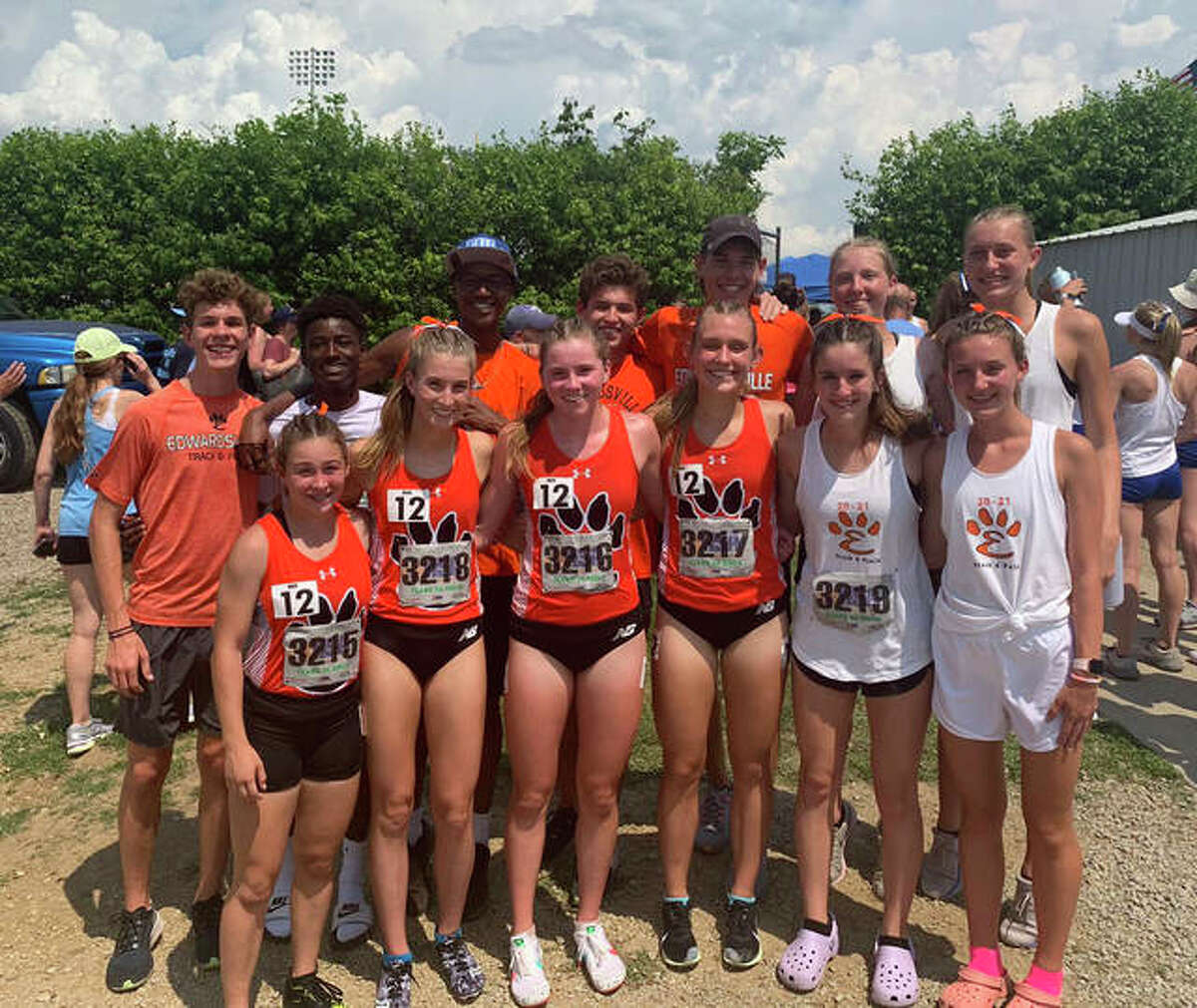 Edwardsville's 3,200-meter relay team of Olivia Coll, front left, Maya Lueking, from second from left, Riley Knoyle, front third from left, and Kaitlyn Loyet, front fourth from left, pose with members of the EHS girls and boys track teams after finishing fifth at the Class 3A state meet.