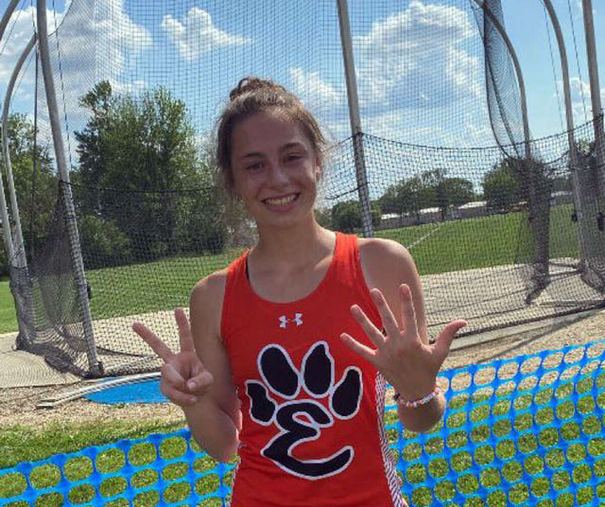Edwardsville's Kaitlyn Morningstar signals her seventh-place finish in the discus.