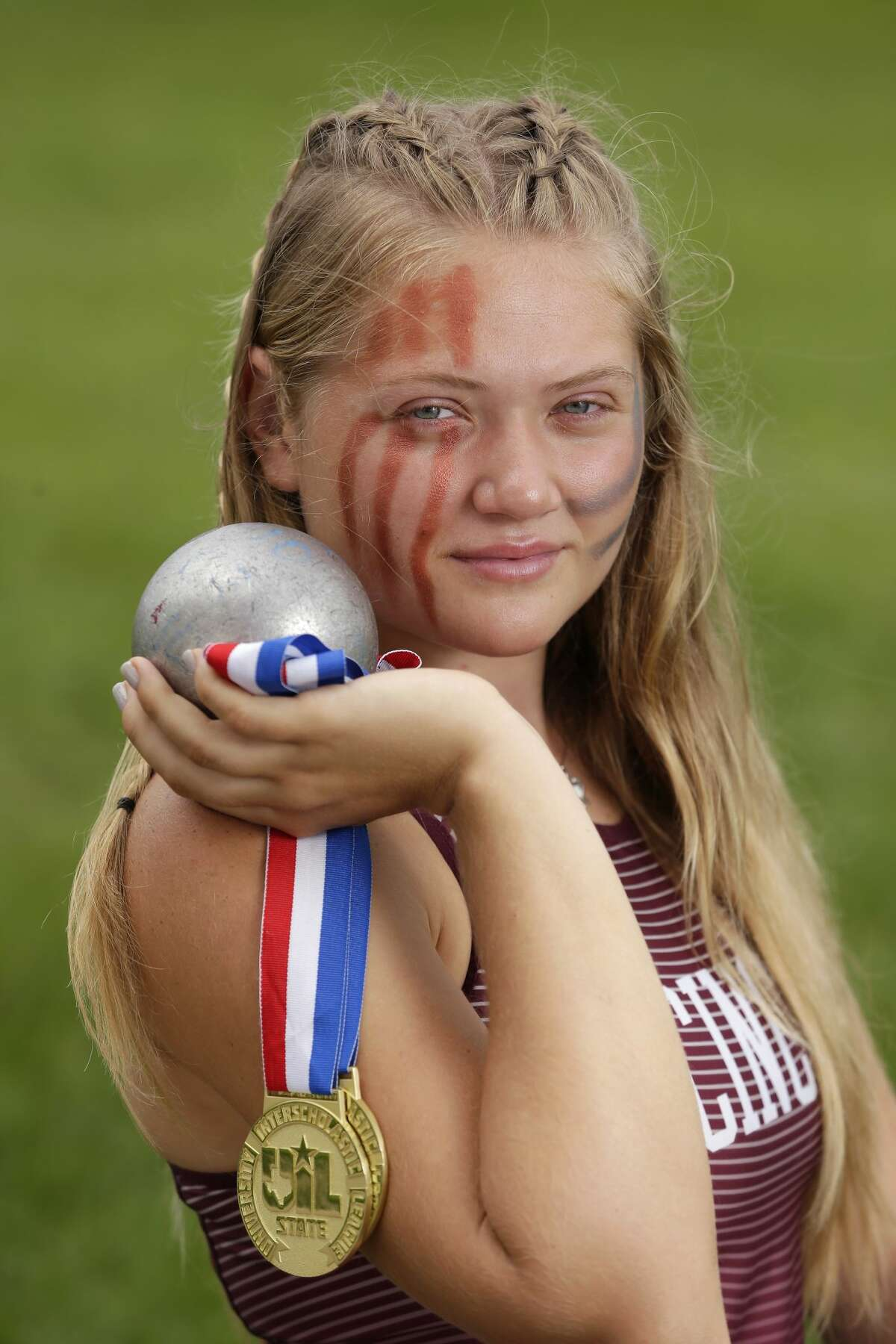 The All Greater Houston Girls Track and Field athlete of the year, Cinco Ranch High School senior Amelia Flynt, with her medals, shot put and discus at her practice field near the school Monday, May 31, 2021 in Katy, TX.