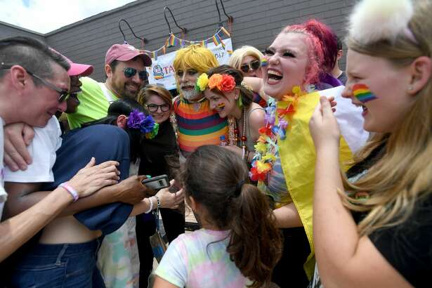 Olivia Gardner brings in the crowd for a group hug after her show-opener during Pride Fest 2021 Saturday at Pour Brothers. Photo made Saturday, June 12, 2021 Kim Brent/The Enterprise