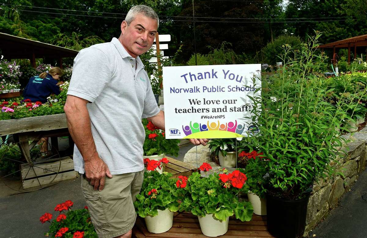 Jeff Deorio owner of Reynold's Farm Nursery Friday, June 11, 2021, is putting up signs for the Day of Gratitude for the NPS staff and organized by the NEF in Norwalk, Conn.