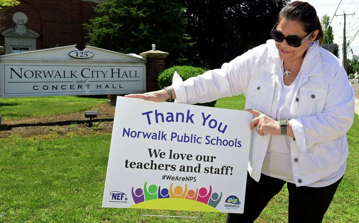 Norwalk Education Foundation board memberat City Hall board Friday, June 11, 2021, is putting up signs for the Day of Gratitude for the NPS staff and organized by the NEF in Norwalk, Conn.