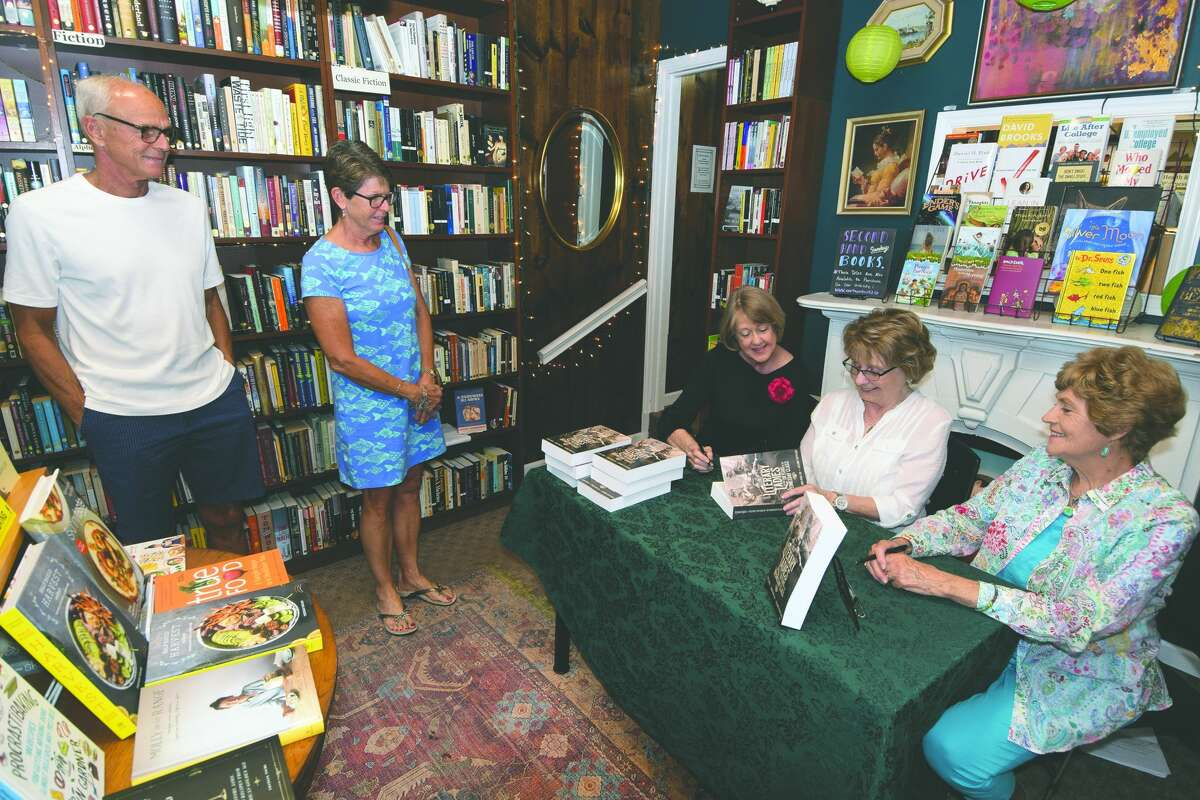 """The authors of """"Literary Ladies"""" sign copies at Our Town Books."""