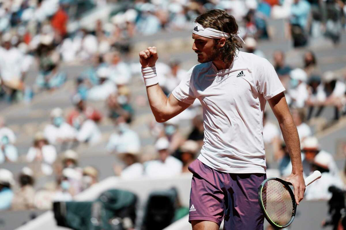 Stefanos Tsitsipas of Greece reacts as he plays Serbia's Novak Djokovic during their final match of the French Open tennis tournament at the Roland Garros stadium Sunday, June 13, 2021 in Paris.