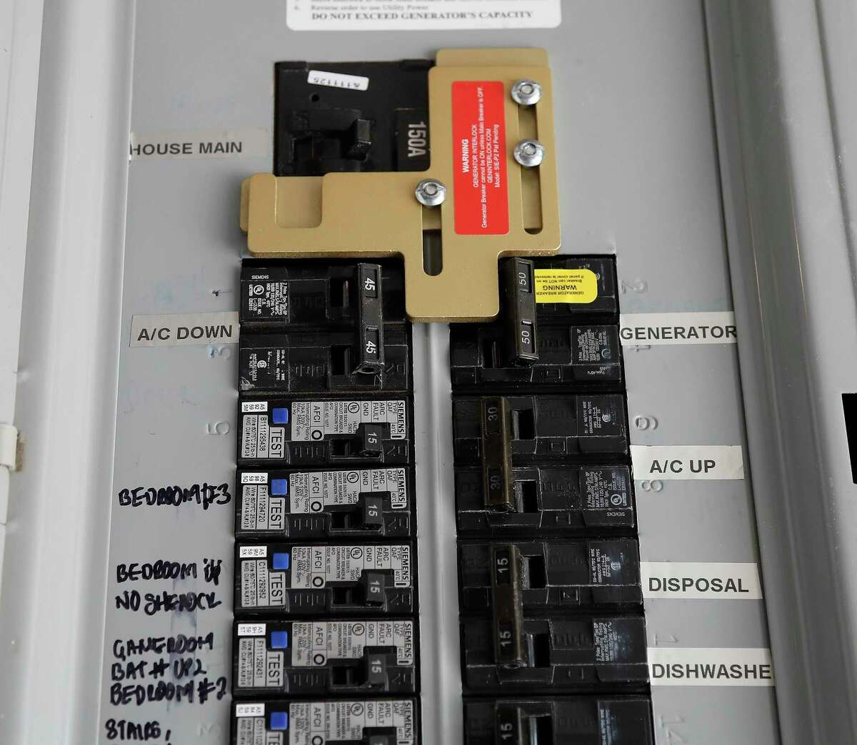 Brian Milan's fuse box with a switch for his portable generator that he has retrofitted to power his home in the event of power outages, Monday, May 24, 2021, in Cypress. Milan, a Cypress resident manages a local Facebook group on retrofitting homes with portable generators.