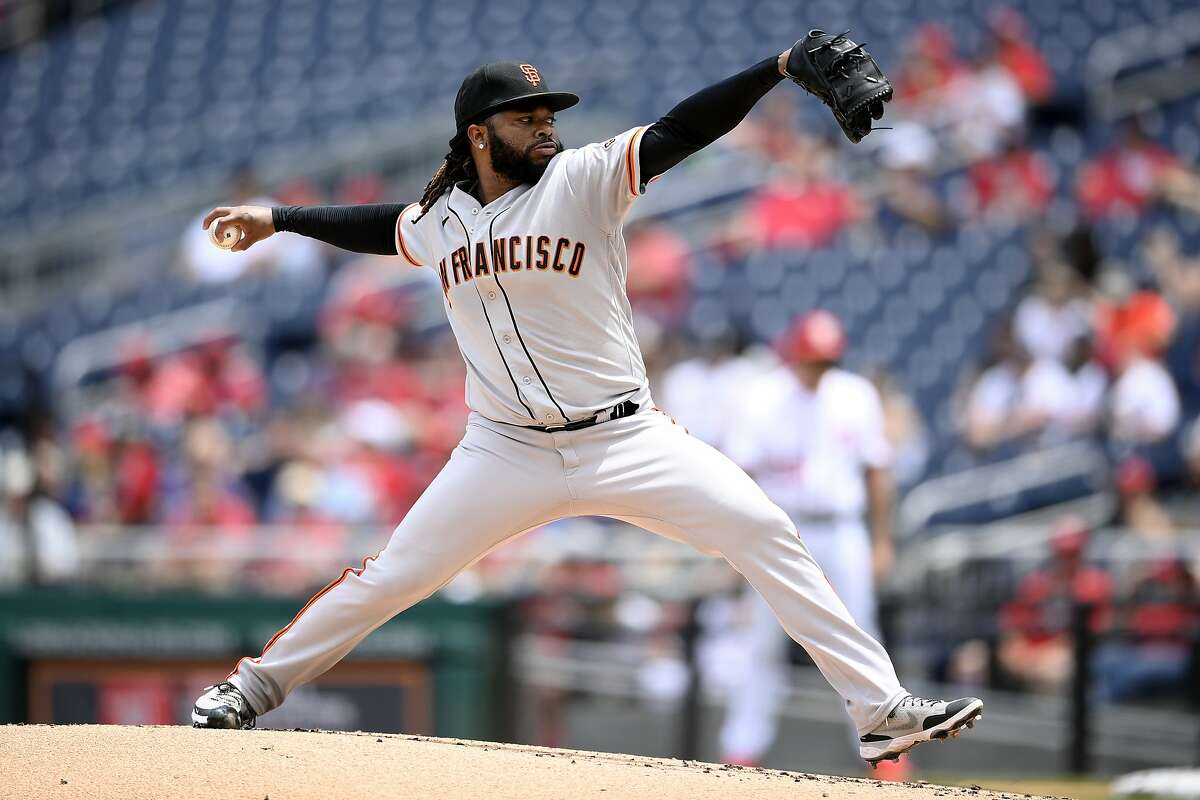 San Francisco Giants starting pitcher Johnny Cueto delivers a pitch during the first inning of a baseball game against the Washington Nationals, Sunday, June 13, 2021, in Washington. (AP Photo/Nick Wass)