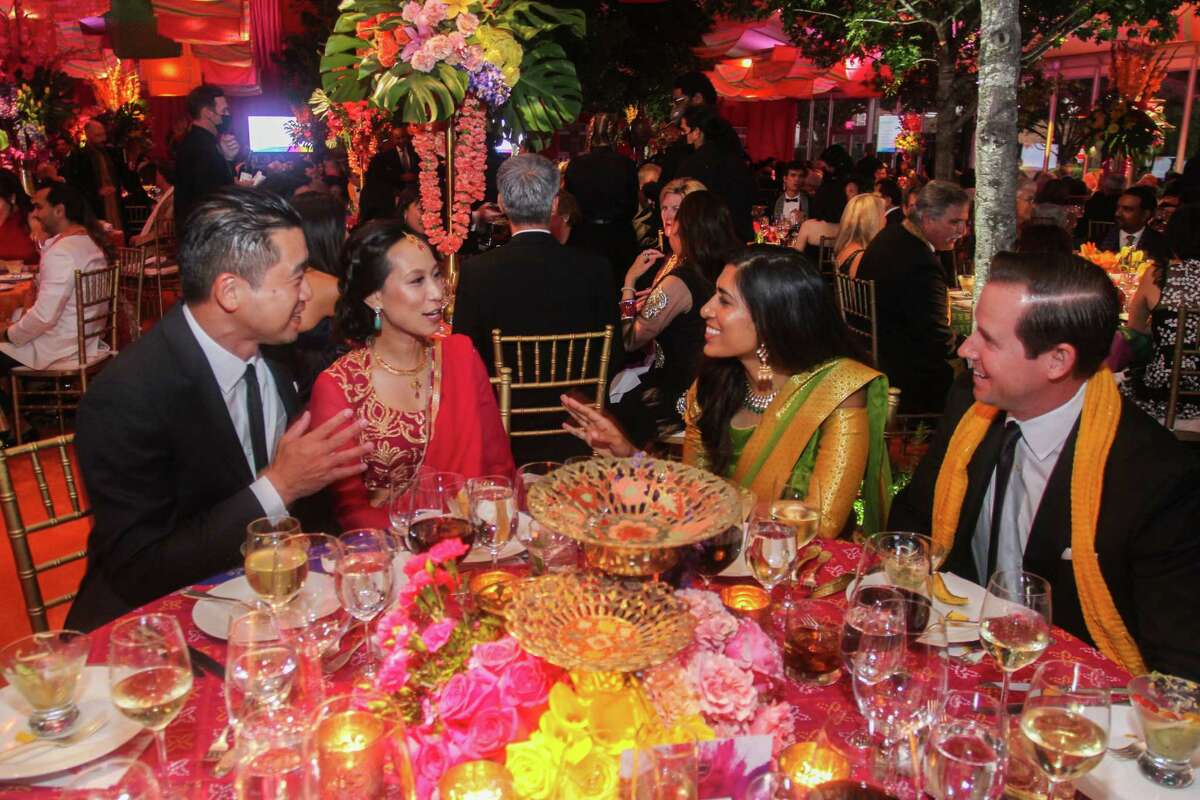 Ken and Janae Tsai, from left, with Divya and Chris Brown at the Asia Society Tiger Ball in Houston on June 11, 2021.