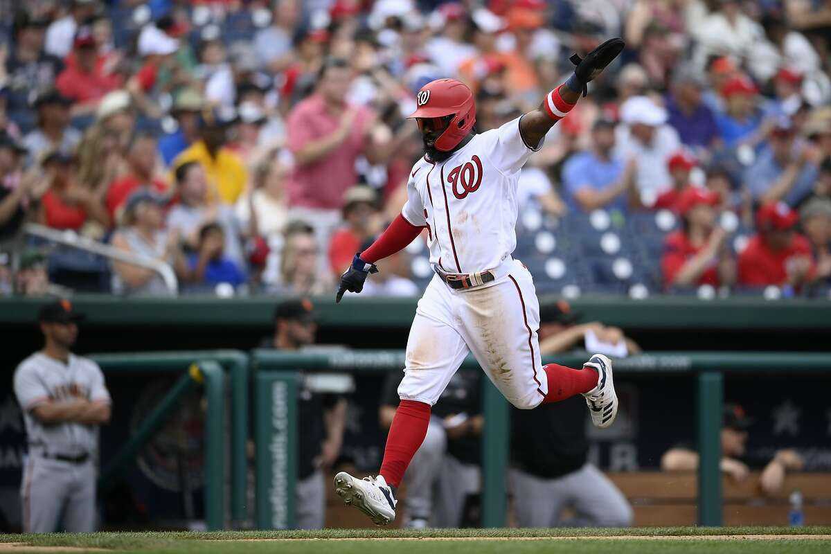 Washington Nationals' Josh Harrison gestures as he runs toward home to score on a double by Starlin Castro during the fifth inning of a baseball game against the San Francisco Giants, Sunday, June 13, 2021, in Washington. (AP Photo/Nick Wass)