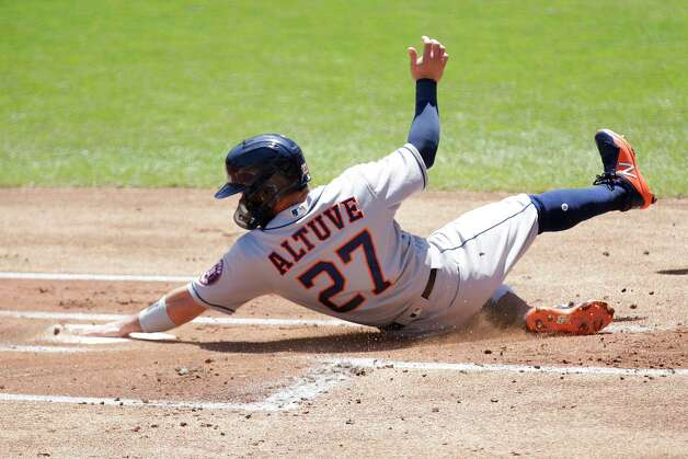 Houston Astros second baseman Jose Altuve scores on a sacrifice fly against the Minnesota Twins in the first inning of a baseball game, Sunday, June 13, 2021, in Minneapolis. (AP Photo/Andy Clayton-King) Photo: Andy Clayton-King, Associated Press / Copyright 2021 The Associated Press All Rights Reserved