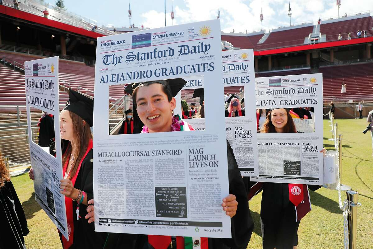 """Students enter Stanford Stadium in a modified """"Wacky Walk"""" during an undergraduate commencement ceremony at Stanford University on Sunday, June 13, 2021, in Stanford, Calif."""