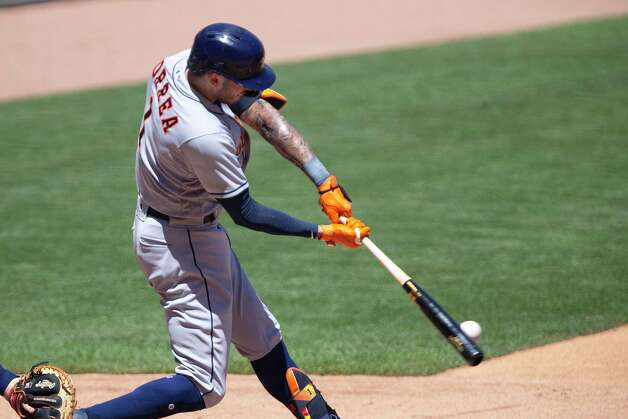 Houston Astros shortstop Carlos Correa hits a single in the fourth inning of a baseball game against the Minnesota Twins, Sunday, June 13, 2021, in Minneapolis. (AP Photo/Andy Clayton-King) Photo: Andy Clayton-King, Associated Press / Copyright 2021 The Associated Press All Rights Reserved