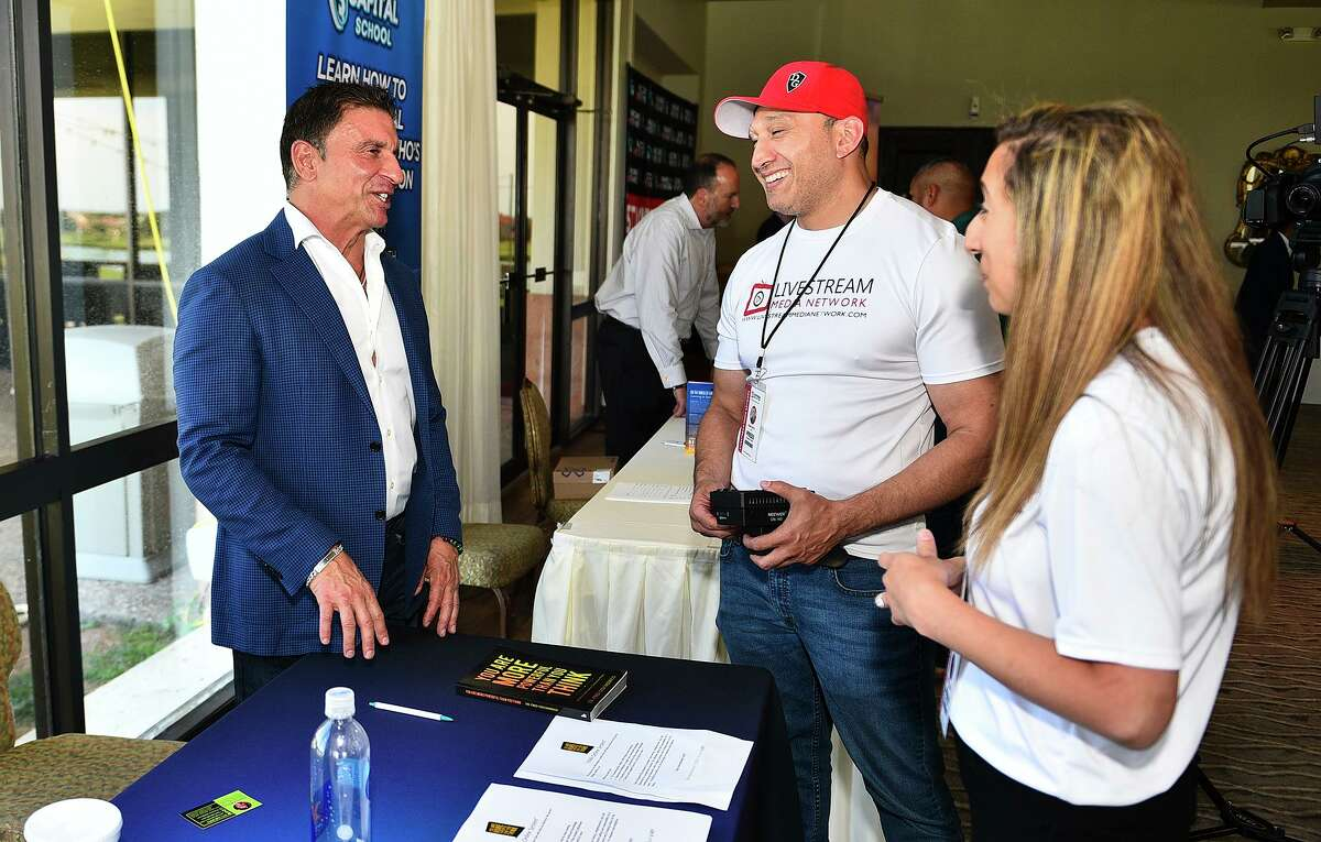 Transformation Specialist Fred DiDomenico networks with Livestream Media Network's Adam Ortiez and Arlene Yammine during the SHIFT Business Accelerator Conference on Saturday.