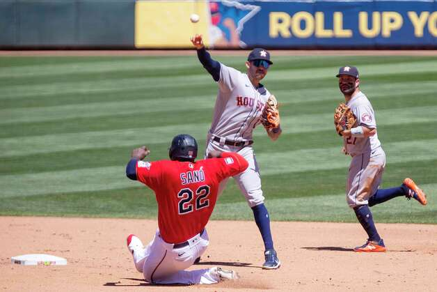 Houston Astros shortstop Carlos Correa (1) throws to first on a double play with Minnesota Twins first baseman Miguel Sano (22) out at second and Astros' Jose Altuve (27) backing up in the fourth inning of a baseball game, Sunday, June 13, 2021, in Minneapolis. (AP Photo/Andy Clayton-King) Photo: Andy Clayton-King, Associated Press / Copyright 2021 The Associated Press All Rights Reserved
