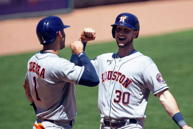Houston Astros' Kyle Tucker (30) celebrates his two-run home run with teammate Carlos Correa (1) in the fourth inning of a baseball game against the Minnesota Twins, Sunday, June 13, 2021, in Minneapolis. (AP Photo/Andy Clayton-King) Photo: Andy Clayton-King, Associated Press / Copyright 2021 The Associated Press All Rights Reserved