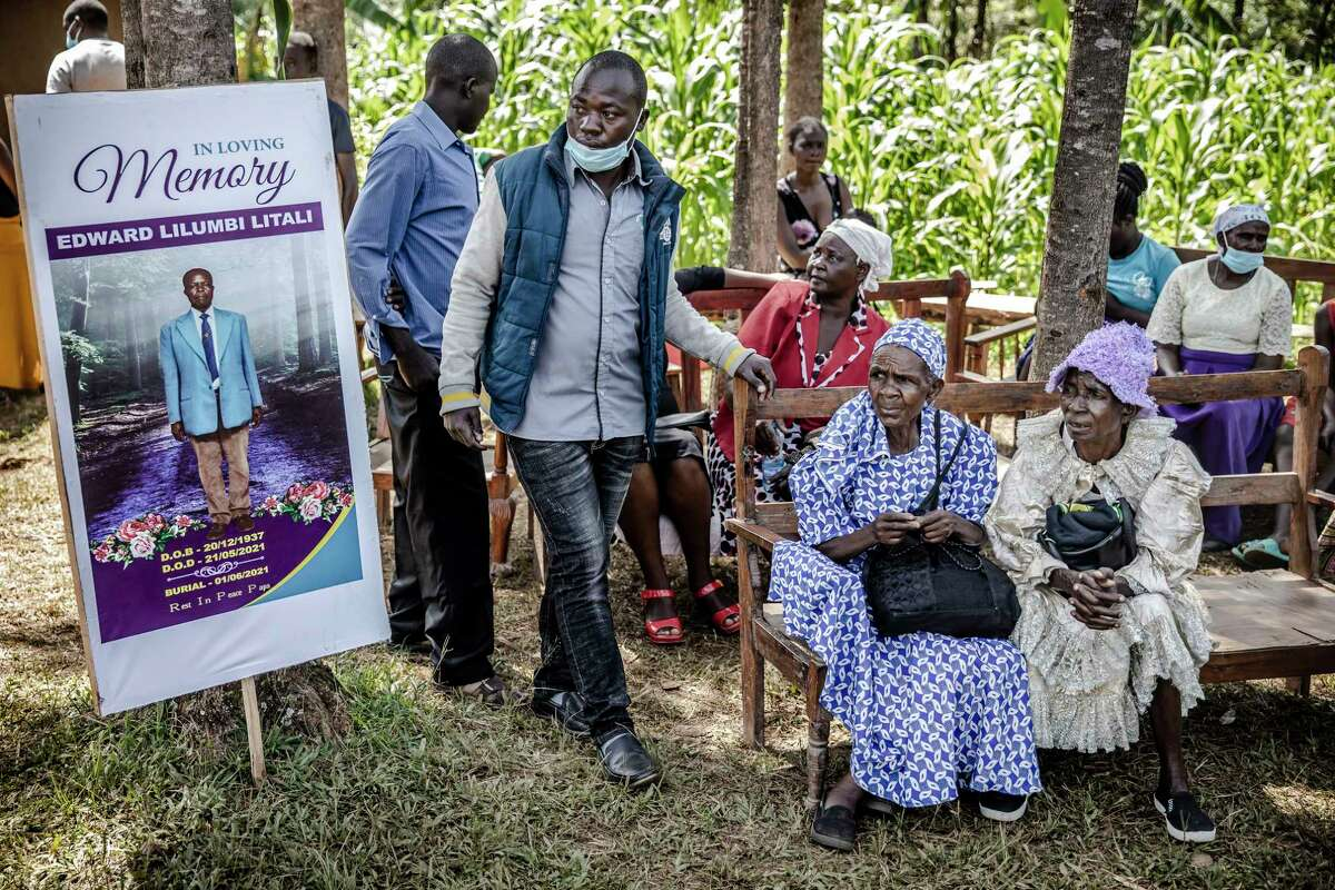 Mourners at the funeral of Edward Lilumbi Litali at his home in Kakamega County, western Kenya.