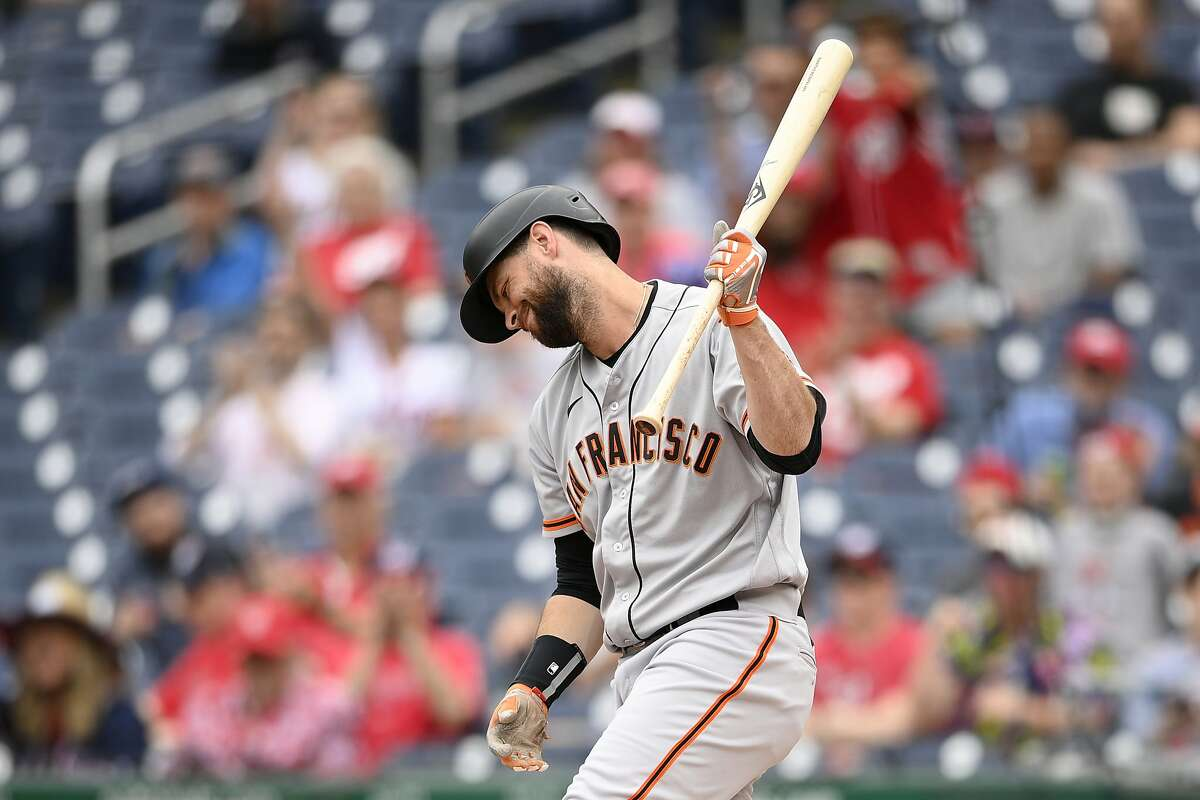 San Francisco Giants' Brandon Belt reacts after he was called out on strikes during the first inning of the first baseball game of a doubleheader, Saturday, June 12, 2021, in Washington. The game is a makeup of a postponed game from Thursday. (AP Photo/Nick Wass)