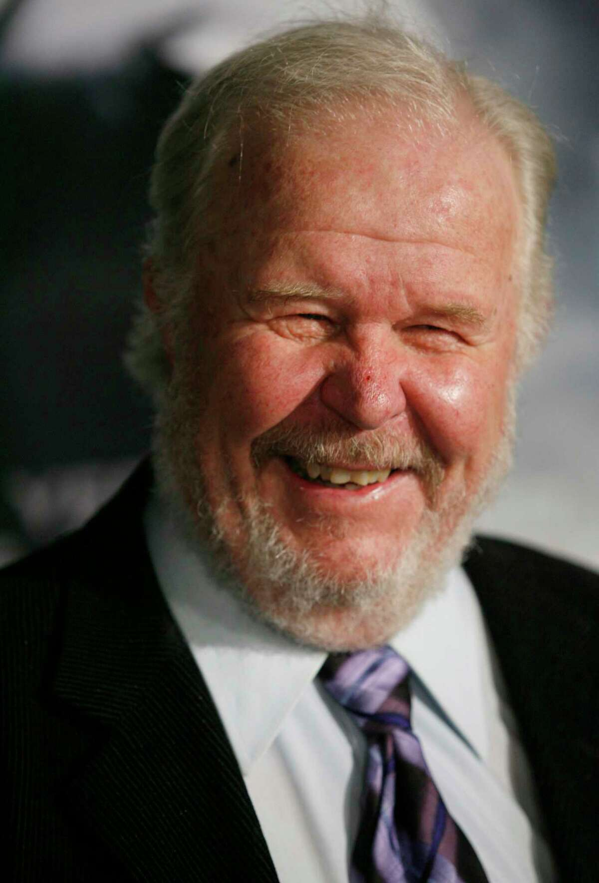 """FILE - In this Thursday, March 8, 2007, file photo, actor Ned Beatty arrives at the premiere of the movie """"Shooter,"""" in Los Angeles. Beatty, the indelible character actor whose first film role, as a genial vacationer brutally raped by a backwoodsman in 1972′s """"Deliverance,"""" launched him on a long, prolific and accomplished career, died Sunday, June 13, 2021. He was 83."""