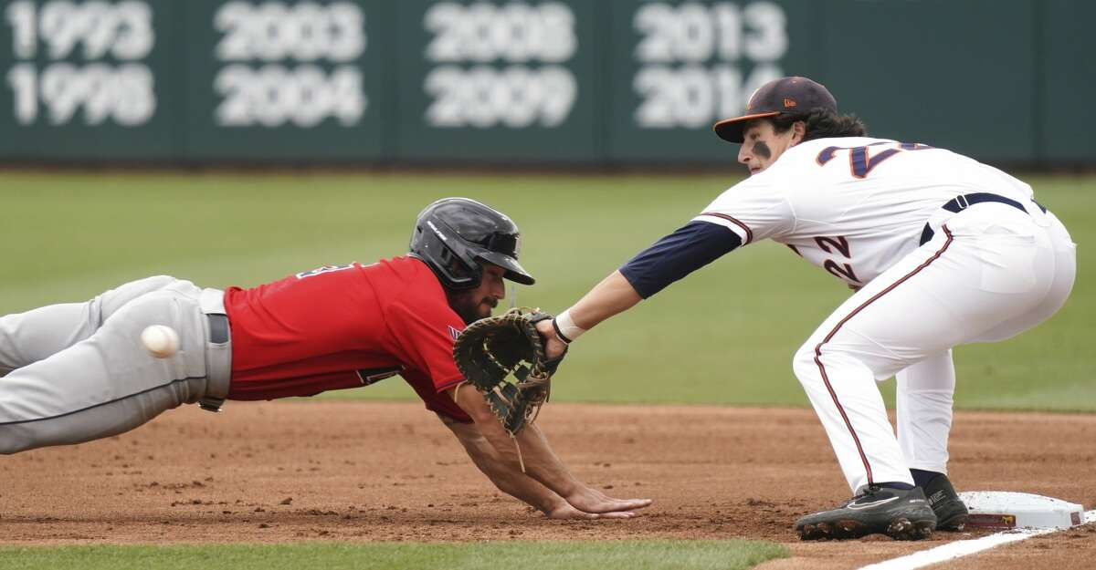 Virginia first baseman Jake Gelof, right, catches the successful pickoff-attempt of Dallas Baptist's Austin Bell during an NCAA college baseball tournament super regional game Sunday, June 13, 2021, in Columbia, S.C. (AP Photo/Sean Rayford)