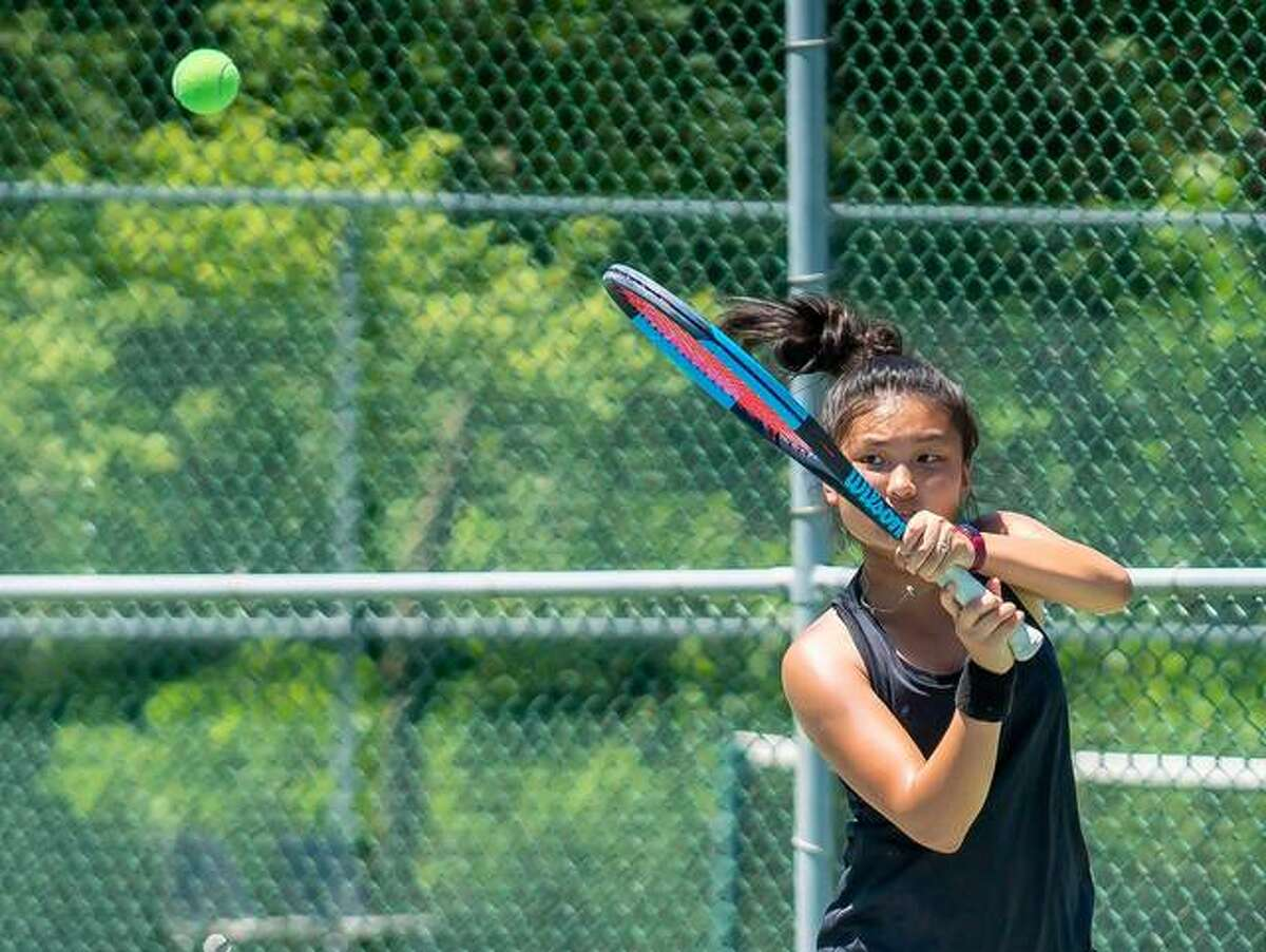 Chloe Koons of Glen Carbon makes a return to Nawal Cheema during their Bud Simpson Open Tournament Women's Open Singles championship match Sunday at the Andy Simpson Tennis Center at Lewis and Clark Community College in Godfrey. The unseeded Koons downed top-seeded Cheema 7-5, 6-4.