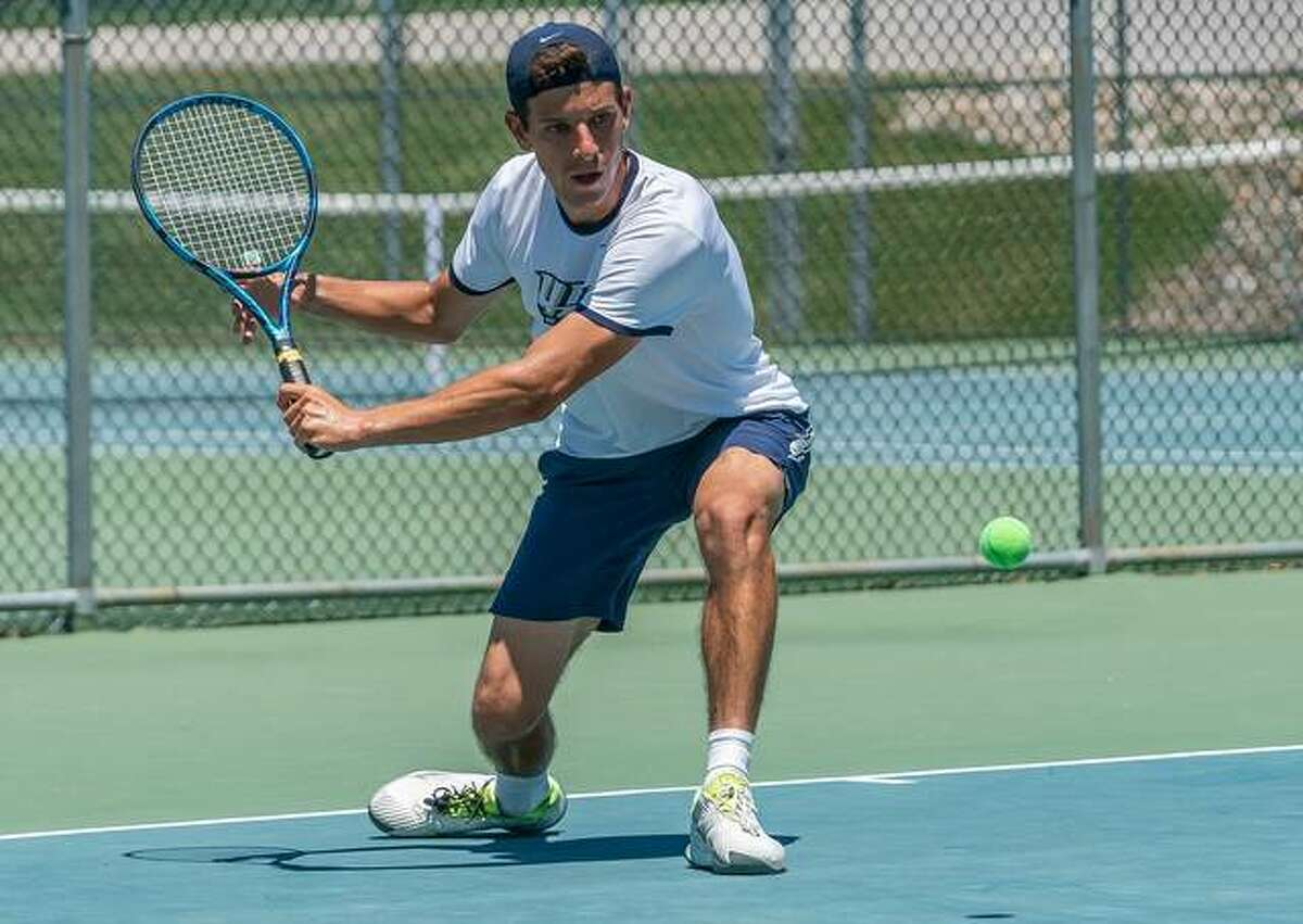 Top-seeded Raul Quevedo Aranda of Springfield returns a shot from Dylan Steffens in Sunday's Men's Open Singles championship match of the Bud Simpson Open Tennis Tournament at the Andy Simpson Tennis Center at Lewis and Clark Community College in Godfrey. Quevedo Aranda won 6-2, 7-6(6).