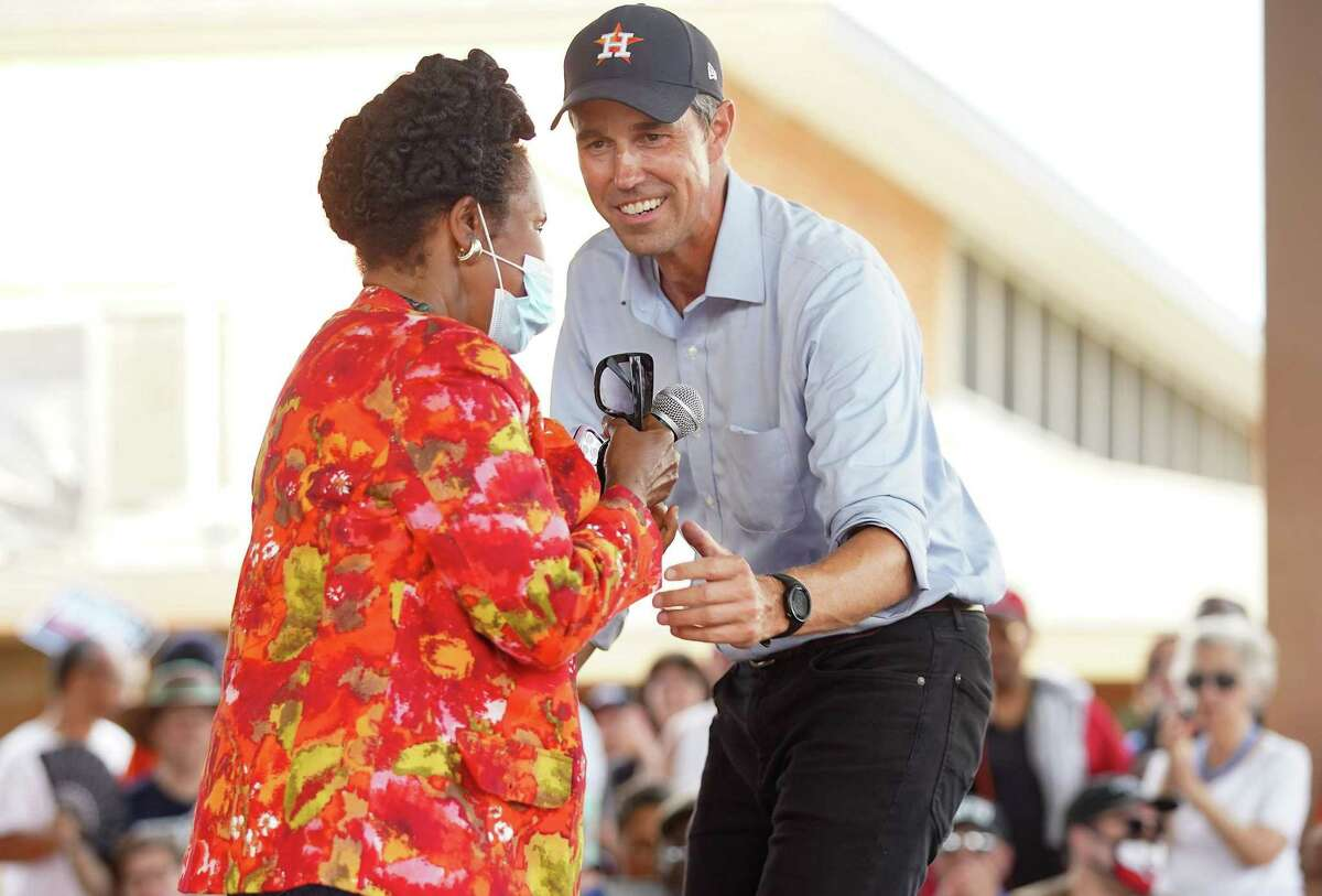 Beto O'Rourke greets U.S. Rep. Sheila Jackson Lee with a hug before handing her the microphone during a rally sponsored by Powered By People at Finnigan Park in Houston's Fifth Ward on Sunday, June 13, 2021.