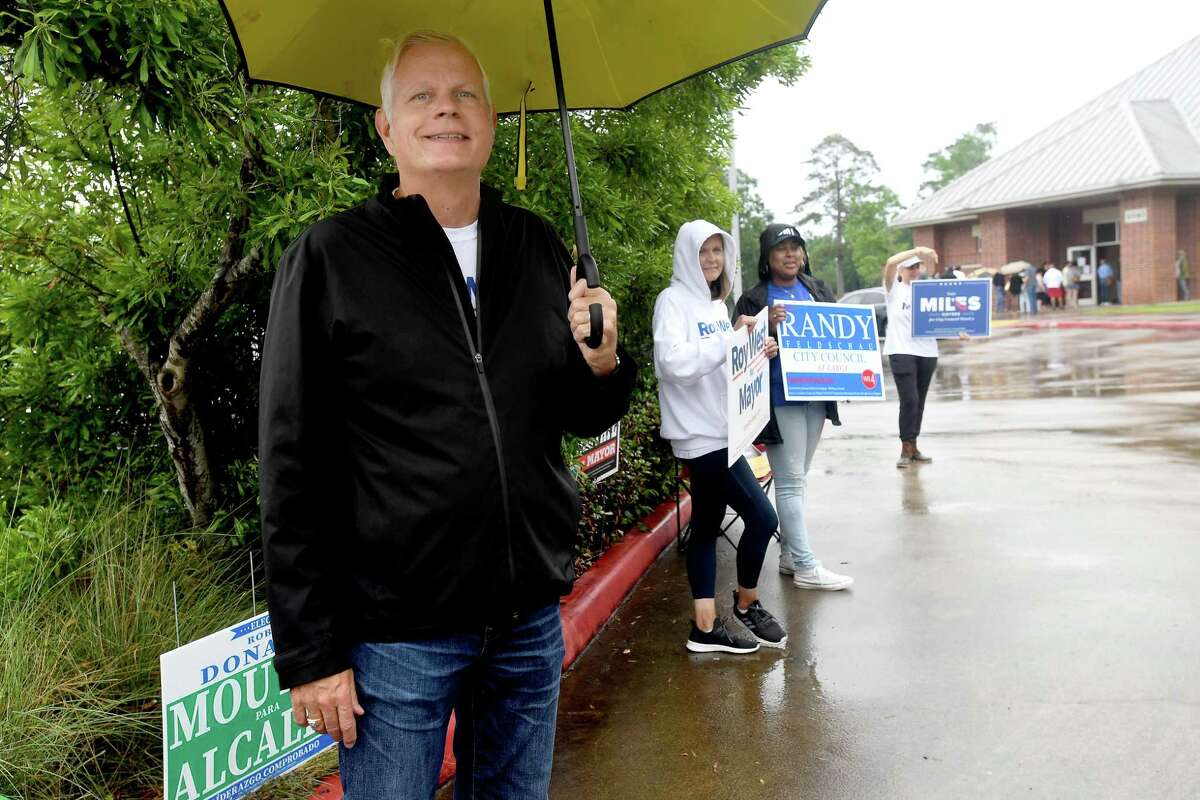 Mayoral candidate Roy West waits to greet voters as candidates and campaign workers make their final bid to voters on election day Saturday. Photo made Saturday, May 1, 2021 Kim Brent/The Enterprise
