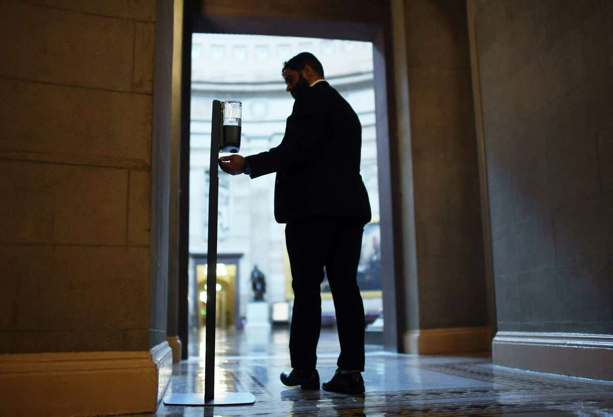 A man uses a hand sanitizer dispenser outside the United States Capitol Rotunda on June 10, 2021 in Washington.