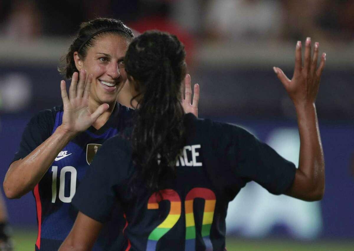 U.S. Women's National Team forward Carli Lloyd (10) congratulates teammate Margaret Purce's (20) goal during the first half of 2021 Summer Series match against the Jamaica Women's National Football Team Sunday, June 13, 2021, at BBVA Stadium in Houston.