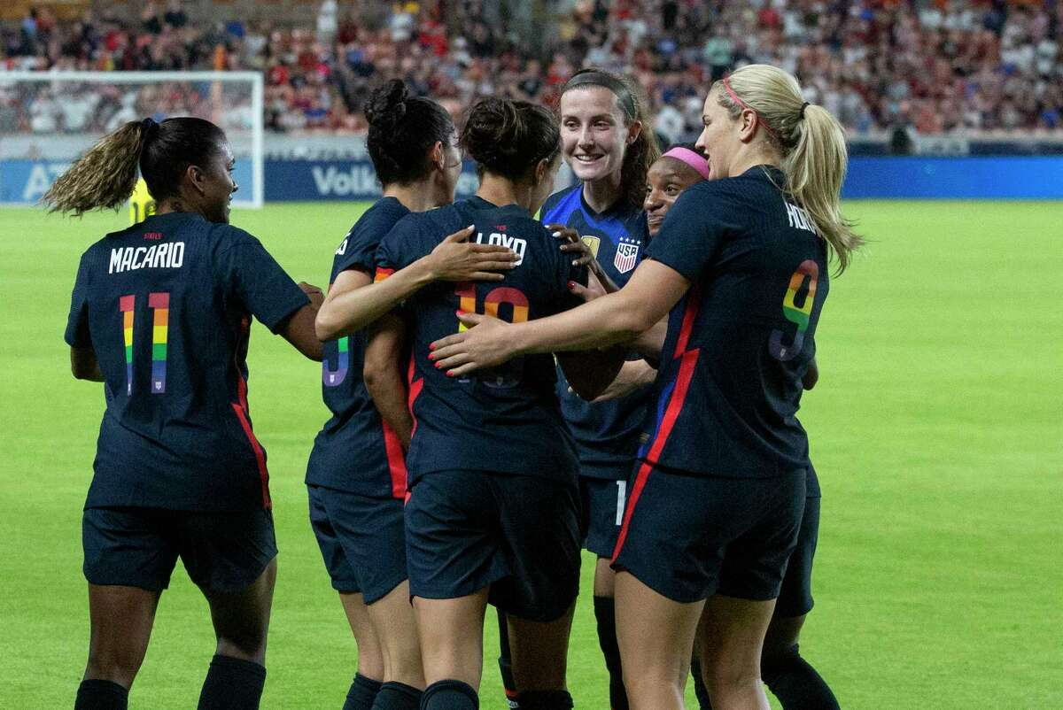 U.S. Women's National Team players congratulate Carli Lloyd for her goal during the first minute of the 2021 Summer Series match against the Jamaica Women's National Football Team Sunday, June 13, 2021, at BBVA Stadium in Houston. Lloyd now holds the record as the oldest goal scorer in the United States history at 38 years and 332 days old.