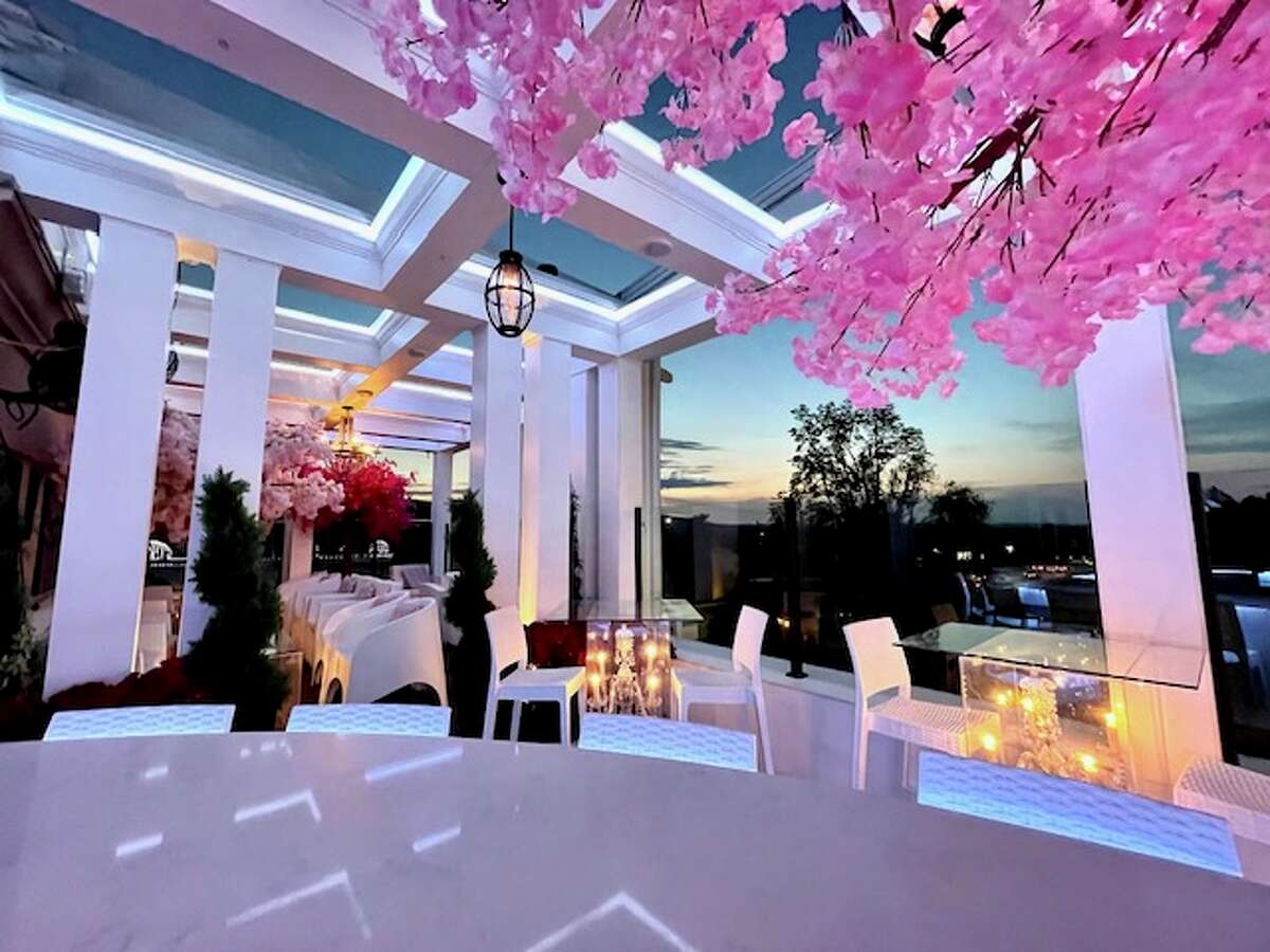 """A look at the new """"Peter Pan""""-themed rooftop dining area at Cava in Southington, Conn. The area includes a floating pirate ship, cherry blossoms and characters from the titular movie."""