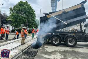 Bethel's Greenwood Avenue railroad crossing reopened Sunday evening following a several-day shutdown due to the formation of a sinkhole.