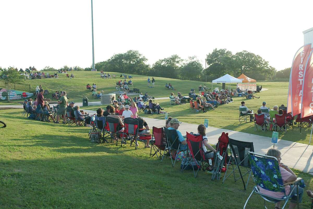 Visitors are covering the green again at events in the city of Pearland's Independence Park now that restrictions for the coronavirus pandemic have been lifted. The city anticipates a crowd for its July Fourth activities in the park. These residents are listening to Kelly McGuire at a June 11 concert in the park.