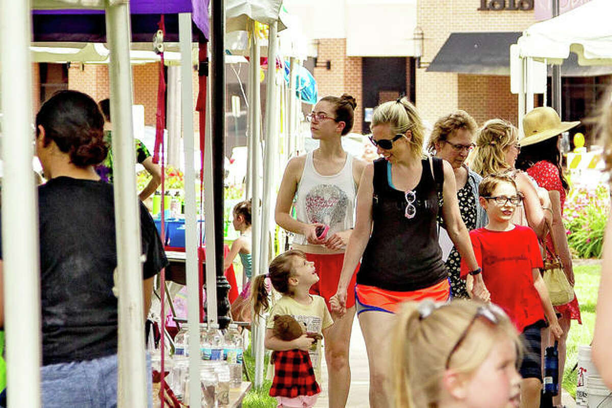 Edwardsville enjoyed a sense of normalcy at the Route 66 Festival Saturday in Edwardsville. The event featured classic cars, vendors, music and a 10k run.