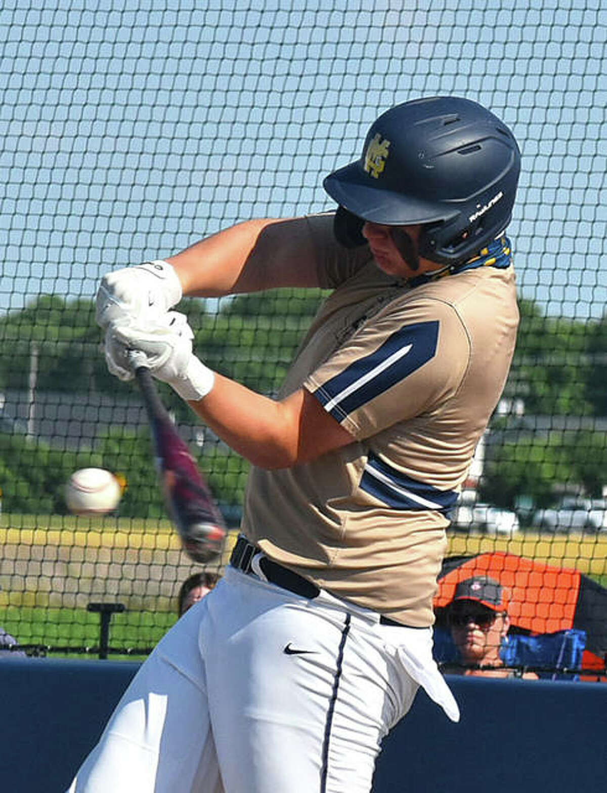Father McGivney's Gabe Smith connects for a two-run triple in the win over Greenfield on Friday in Glen Carbon.