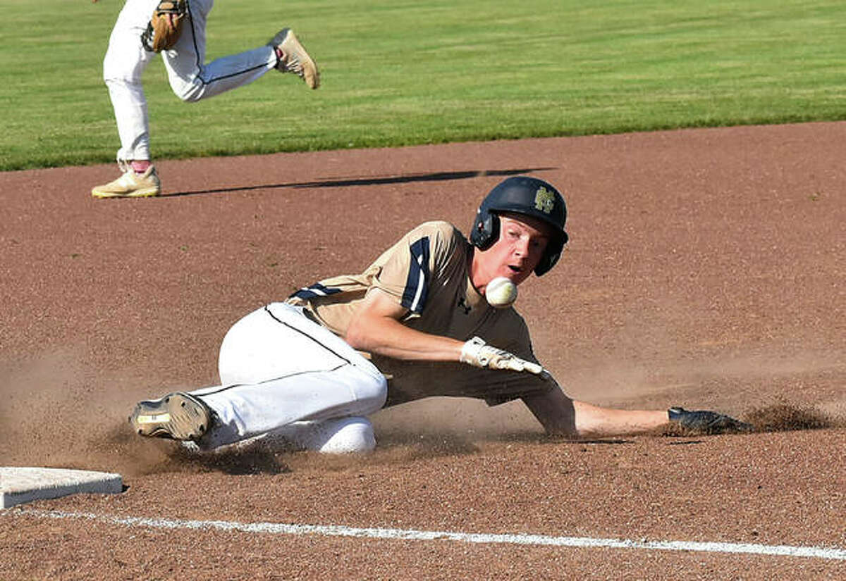 Father McGivney's Drew Sowerine is hit in the chest by the baseball as he steals third base during Friday's sectional championship game against Greenfield in Glen Carbon.