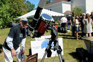 The Litchfield Hills Amateur Astronomy Club is resuming its Star Parties at White Memorial Conservation Center in Litchfield, as well as other events, after waiting for more than a year. Club secretary Denis Williamson checks his solar telescope.