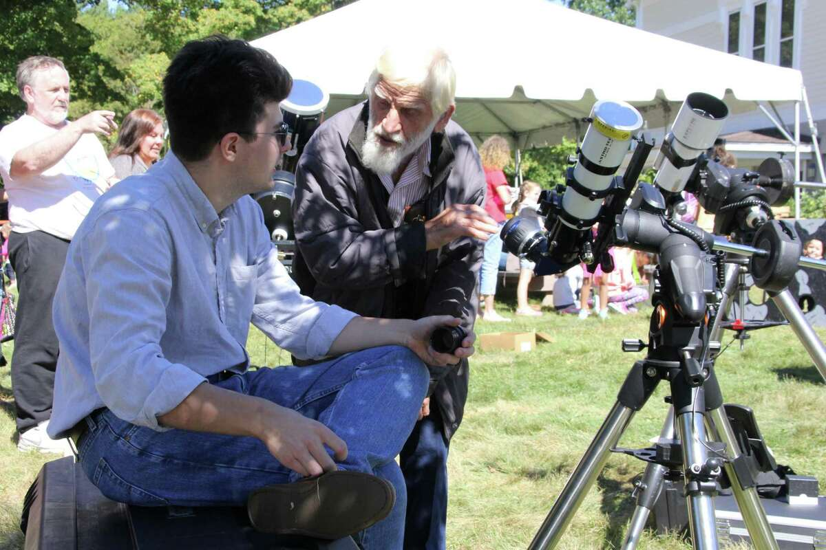 The Litchfield Hills Amateur Astronomy Club is resuming its Star Parties at White Memorial Conservation Center in Litchfield, as well as other events, after waiting for more than a year. In this photo, the late Paul Pompa, a founder of the club, chats with fellow member Liam O'Brien during an event at White Memorial Conservation Center in Litchfield.