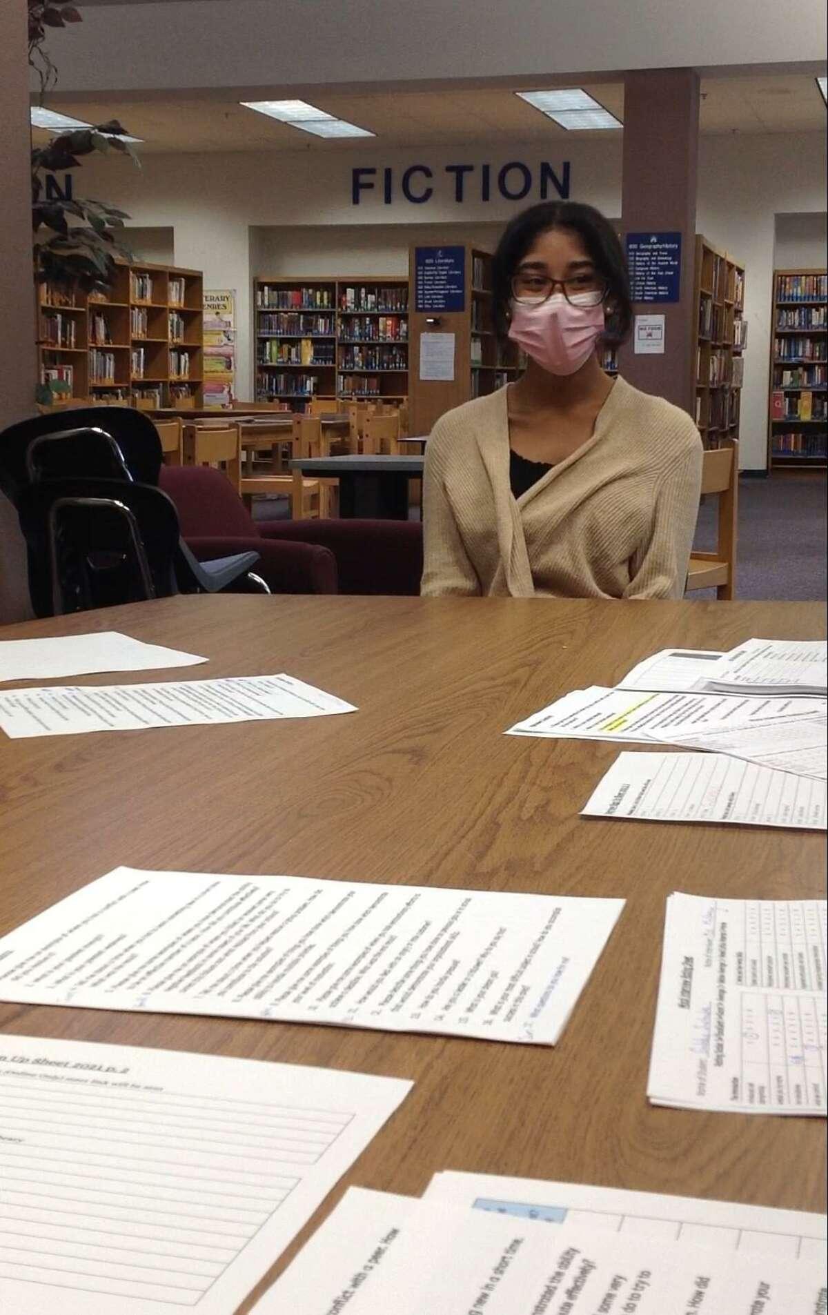 Gabriela Sustache takes her final exam, a mock job interview, at the Gilbert School.