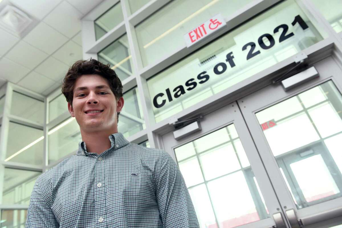 West Haven High School valedictorian Hunter Axelrod inside the entrance to the school on June 9, 2021.