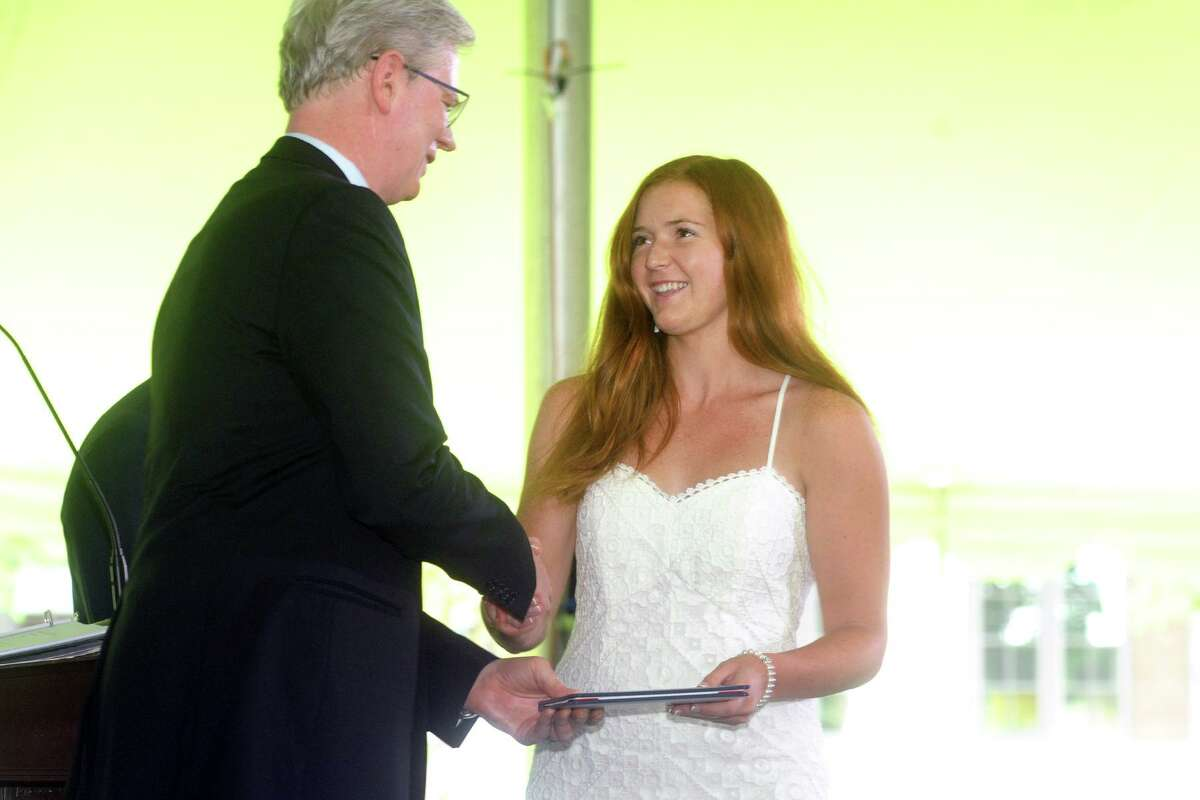 Marygrace DelliSanti walks up to receive her diploma at the start of the 2021 class at Greens Farms Academy in Westport, Connecticut on June 10, 2021.