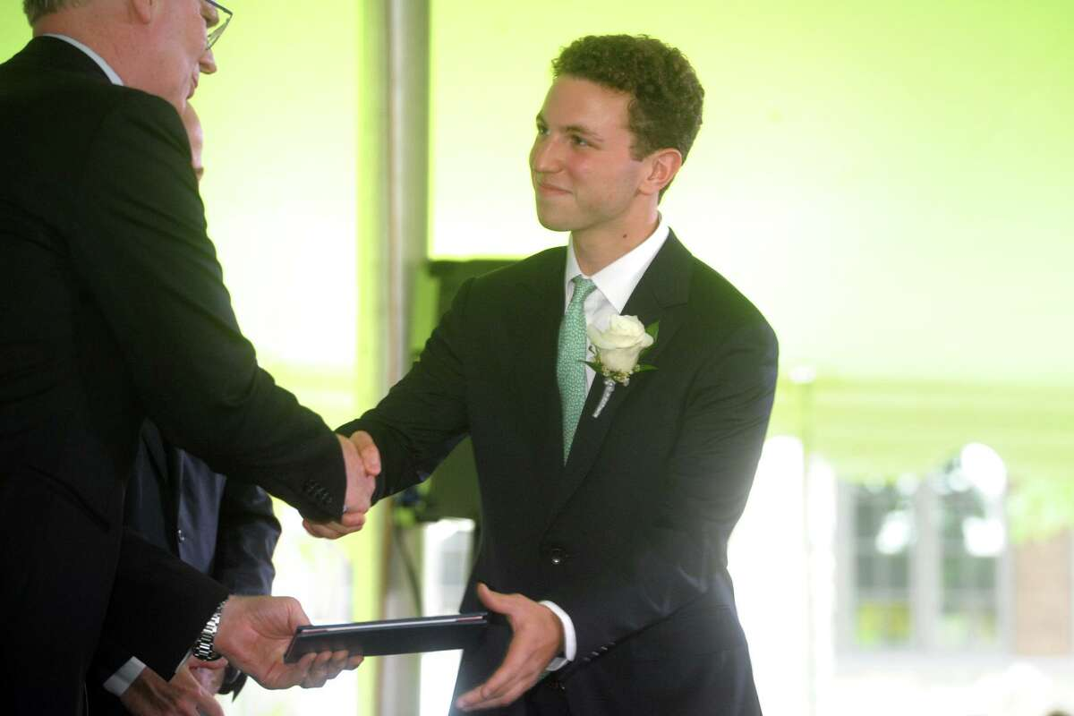 Brian Greenspan walks up to receive his diploma at the start of the 2021 class at Greens Farms Academy in Westport, Connecticut on June 10, 2021.
