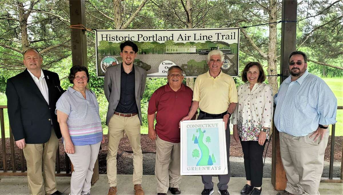 From left are Bruce Donald, chairman of the Connecticut Greenways Council; Laurie Giannotti of the state Department of Energy and Environmental Protection Trails and Greenway Program; Mason Trumble, DEEP deputy commissioner; Rosario Rizzo, chairman, Portland Air Line Trail Committee; Portland Selectman Lou Pear, liaison to the Air Line Trail Committee; Portland First Selectwoman Susan Bransfield and Selectman Jim Tripp.