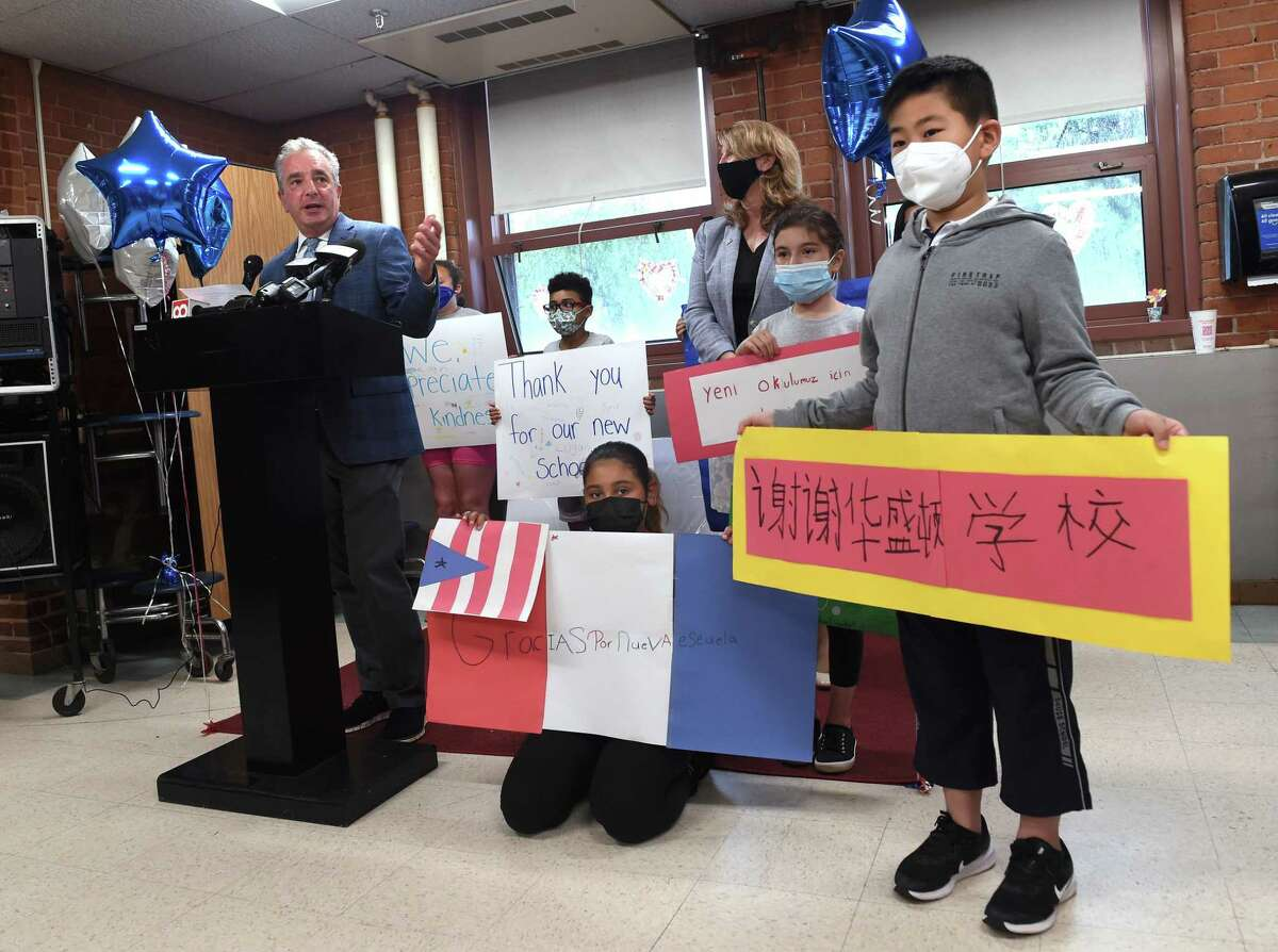 West Haven Superintendent of Schools Neil Cavallaro, left, speaks during a press conference announcing $24 million in funding toward the cost of a new Washington Elementary School in West Haven on June 14, 2021. At right is third-grader Chenxi Dong.