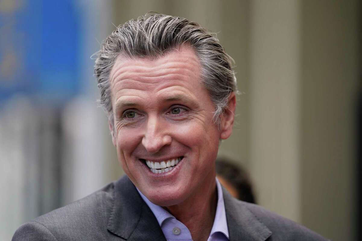 California Gov. Gavin Newsom smiles during a news conference in San Francisco, on Thursday, June 3, 2021. Newsom has signed an executive order that will lift most of the state's coronavirus rules. The order Newsom signed Friday, June 11, 2021, takes effect Tuesday. It will end the state's stay-at-home order and its various amendments.