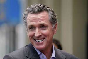 California Gov. Gavin Newsom smiles during a news conference in San Francisco, on Thursday,  June 3, 2021. California Gov. Gavin Newsom has signed an executive order that will lift most of the state's coronavirus rules. The order Newsom signed Friday, June 11, 2021, takes effect on Tuesday. It will end the state's stay-at-home order and its various amendments.